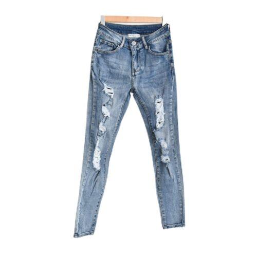 JEANS skinny strappato Abbigliamento